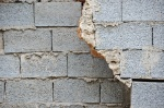 Broken cinder block brick wall background texture.