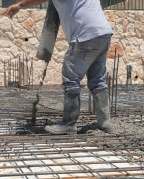 construction worker pouring concrete
